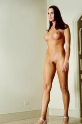 http://img296.imagevenue.com/loc339/th_044384330_met_art_tw_erika_0017_123_339lo.jpg
